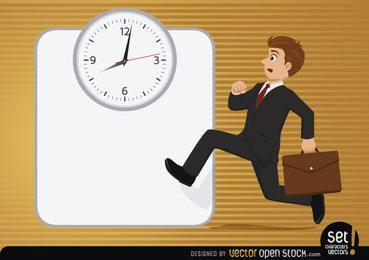 Executive running with clock