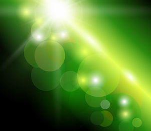 Fundo verde com luz solar natural de Bokeh