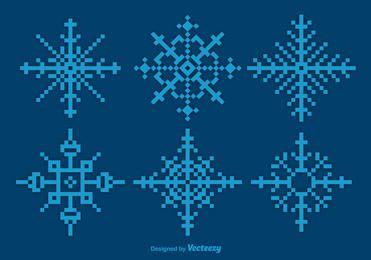 Conjunto de copos de nieve azul pixelado
