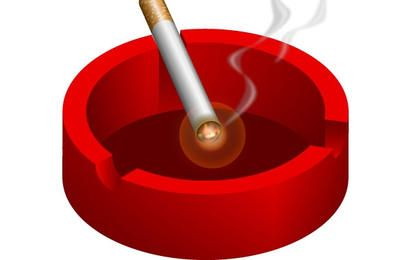 Ashtray with burning cigarette free vector