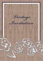 Convite vintage com flores sobre a madeira