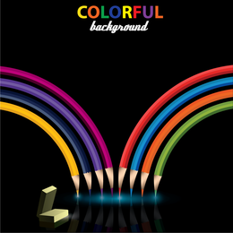 Colorful pencils over black backdrop
