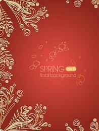Goldene Blumenverzierung auf Paprika-Hintergrund