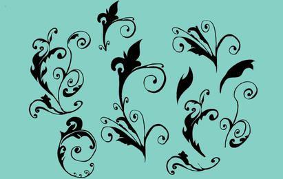Enfeites florais vetoriais encaracolados