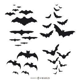 Silhuetas de morcegos voando conjunto