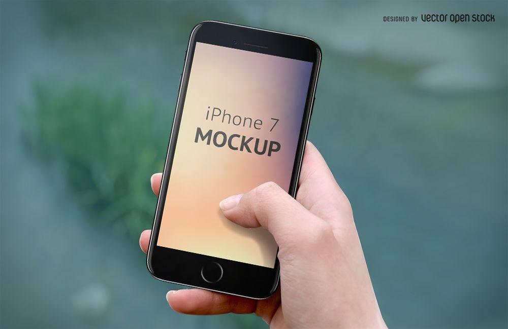 iPhone 7 mockup on hand PSD