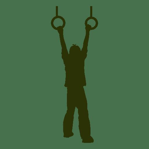 Boy hanging trapeze rings