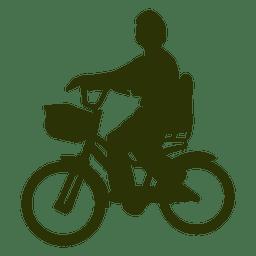 Niño montado en silueta de la bicicleta