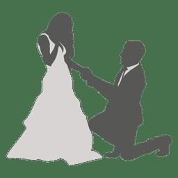 Groom kneeling to bride