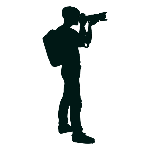 Photographer with backpack shooting silhouette