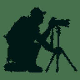 Fotógrafo con soporte de cámara silueta.