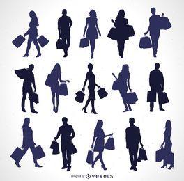 Siluetas de personas con bolsas de compras