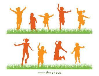 Niños saltando silueta conjunto