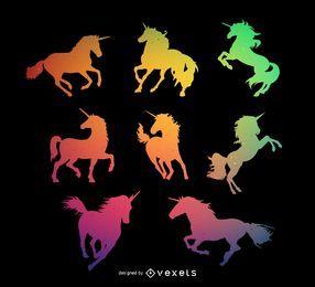 Conjunto de silueta de unicornio colorido