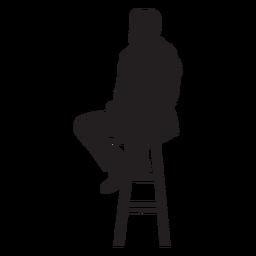 Hombre sentado en la silueta del taburete de la barra