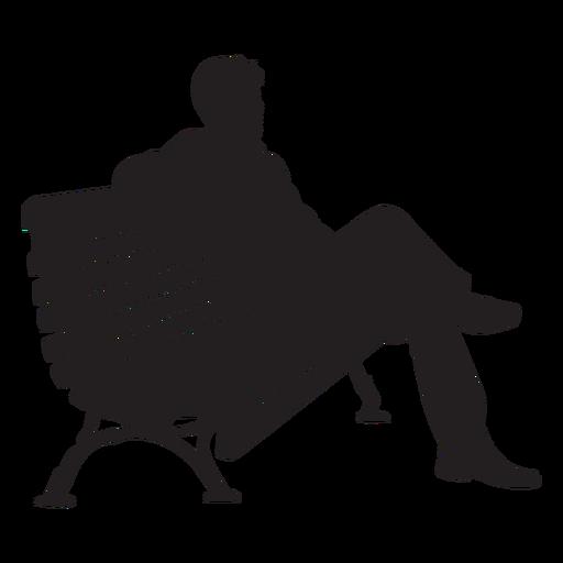 Hombre que sienta en banco silueta