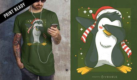 Diseño de camiseta navideña de pingüino.