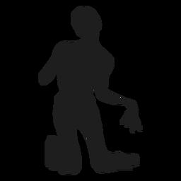 Zombie en silueta de rodillas