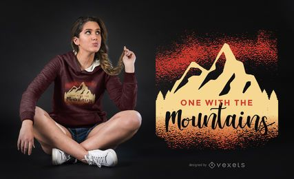 Um com o design do t-shirt das montanhas