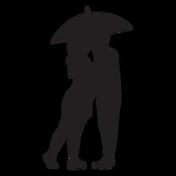 Beijando sob a silhueta de guarda-chuva