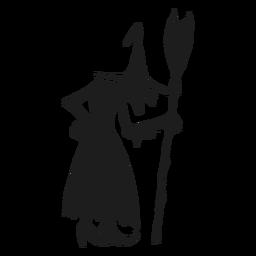 Bruxa em pé com uma silhueta de vassoura
