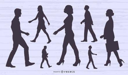 Conjunto de silueta de vista lateral de personas caminando