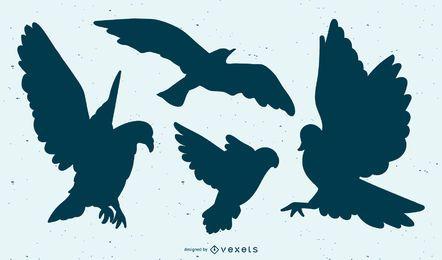 Conjunto de silhueta de pássaro voador