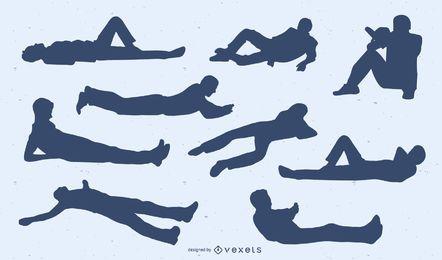 Conjunto de siluetas de hombres tendidos