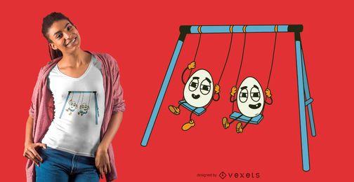 Diseño de camiseta de huevos en columpio