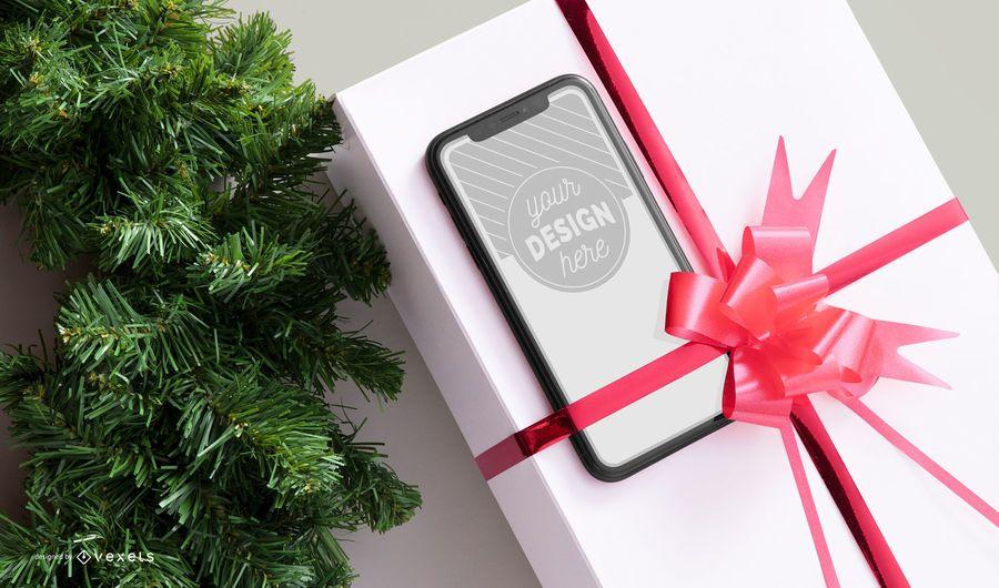 Maquete de smartphone de presente de Natal