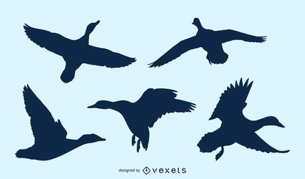 Duck flying silhouette set