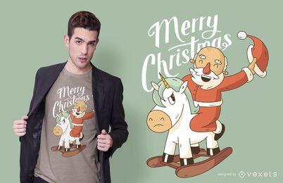 Diseño de camiseta de unicornio montando santa