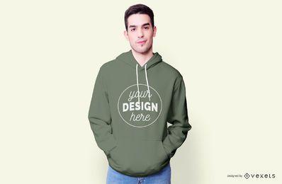 Kerl, der Hoodie-Modell trägt