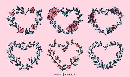 Conjunto de corações de grinaldas de flores