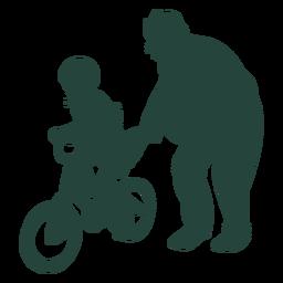 Criança mais velha aprende a andar de bicicleta sênior