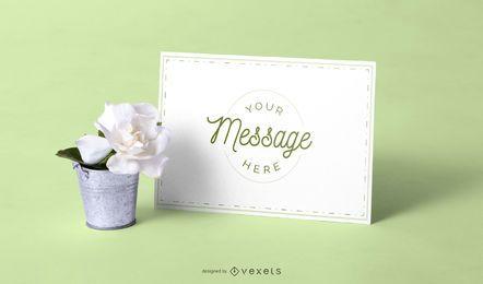 Maquete de cartão e flor