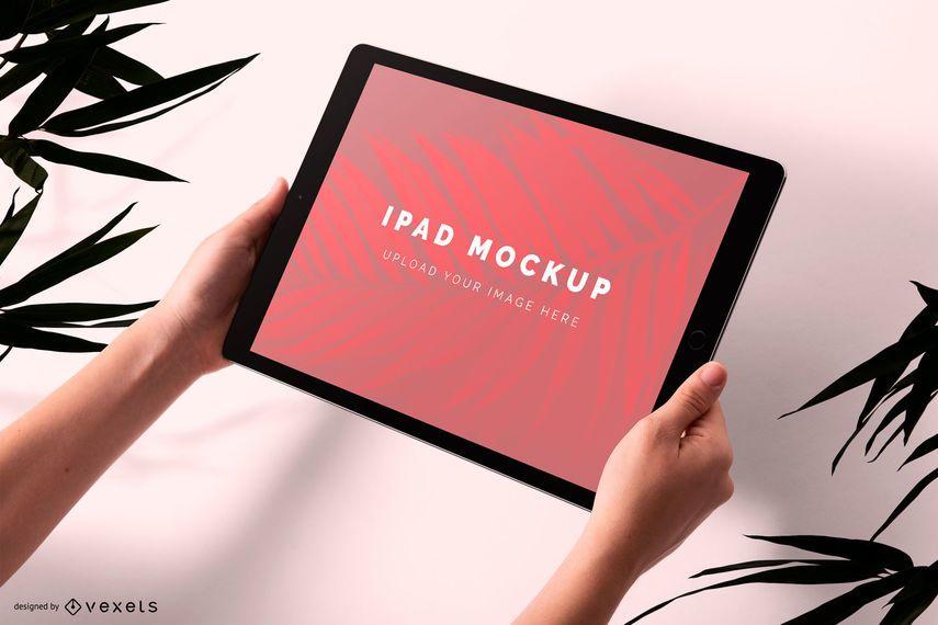 Holding Ipad mockup design
