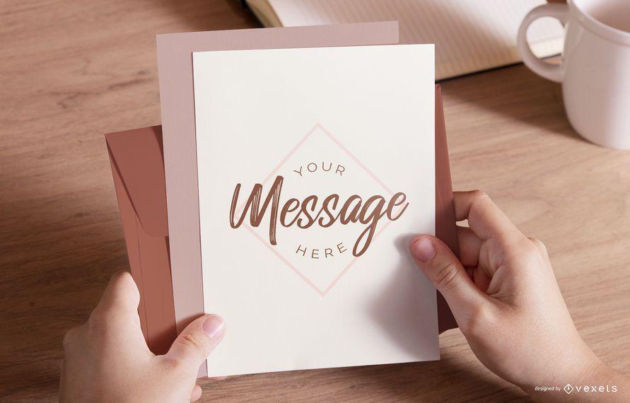 Hands holding envelope mockup