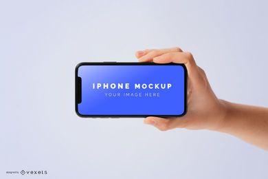 Mão segurando o modelo de iphone