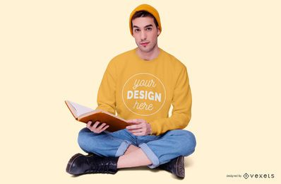 Boy Reading Sitting Down Sweatshirt Mockup