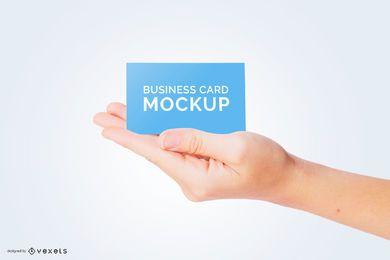 Cartão de visita na mão maquete