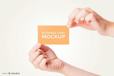 Hands holding business card mockup