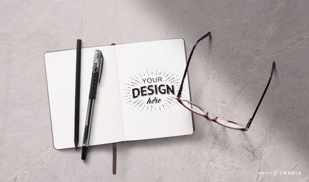Maqueta de papelería de cuaderno abierto