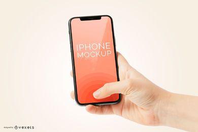 Mão segurando o iPhone 11 telefone maquete