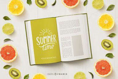 Composición de maquetas de libros y frutas