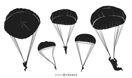Paquete de silueta de personas en paracaídas