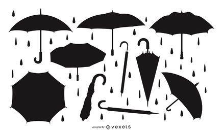 Conjunto de silueta de paraguas y lluvia