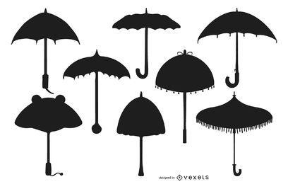 Conjunto de diseño de silueta de paraguas