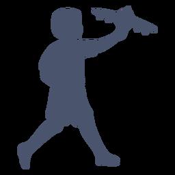 Niño jugando con silueta de avión
