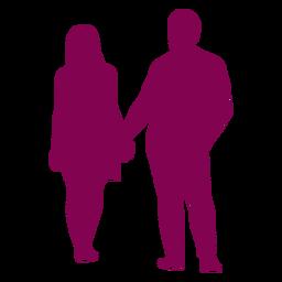 Casal em pé de mãos dadas em silhueta